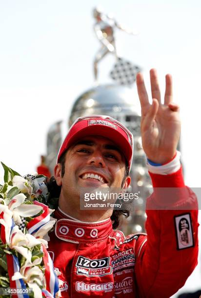 Dario Franchitti of Scotland driver of the Target Chip Ganassi Racing Honda holds up three fingers signifying his 3 career Indianapolis 500 Victories...
