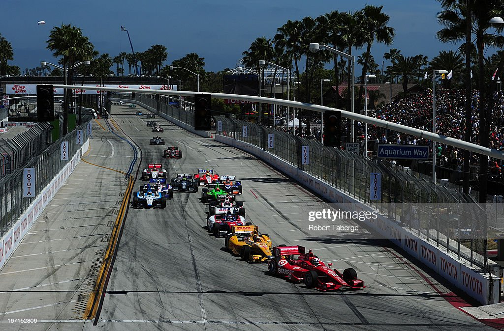 <a gi-track='captionPersonalityLinkClicked' href=/galleries/search?phrase=Dario+Franchitti&family=editorial&specificpeople=171306 ng-click='$event.stopPropagation()'>Dario Franchitti</a> of Scotland driver of the #10 Target Chip Ganassi Racing Dallara Honda leads the field at the start of the IndyCar Series Toyota Grand Prix of Long Beach on April 21, 2013 on the streets of Long Beach, California.