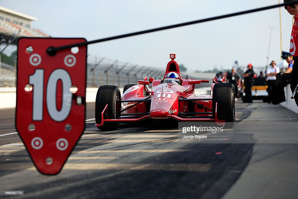 <a gi-track='captionPersonalityLinkClicked' href=/galleries/search?phrase=Dario+Franchitti&family=editorial&specificpeople=171306 ng-click='$event.stopPropagation()'>Dario Franchitti</a> of Scotland, driver of the #10 Target Chip Ganassi Racing Honda, practices ahead of Bump Day qualifying at Indianapolis Motor Speedway on May 19, 2013 in Indianapolis, Indiana.