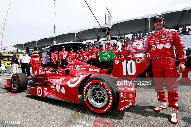 Dario Franchitti of Scotland driver of the Target Chip Ganassi Racing Honda poses with the Verizon P1 Pole Award following qualifying for the IZOD...