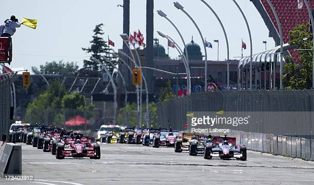 Dario Franchitti of Scotland driver of the Target Chip Ganassi Racing Honda Dallara sits in pole position on the grid as the standing start is...
