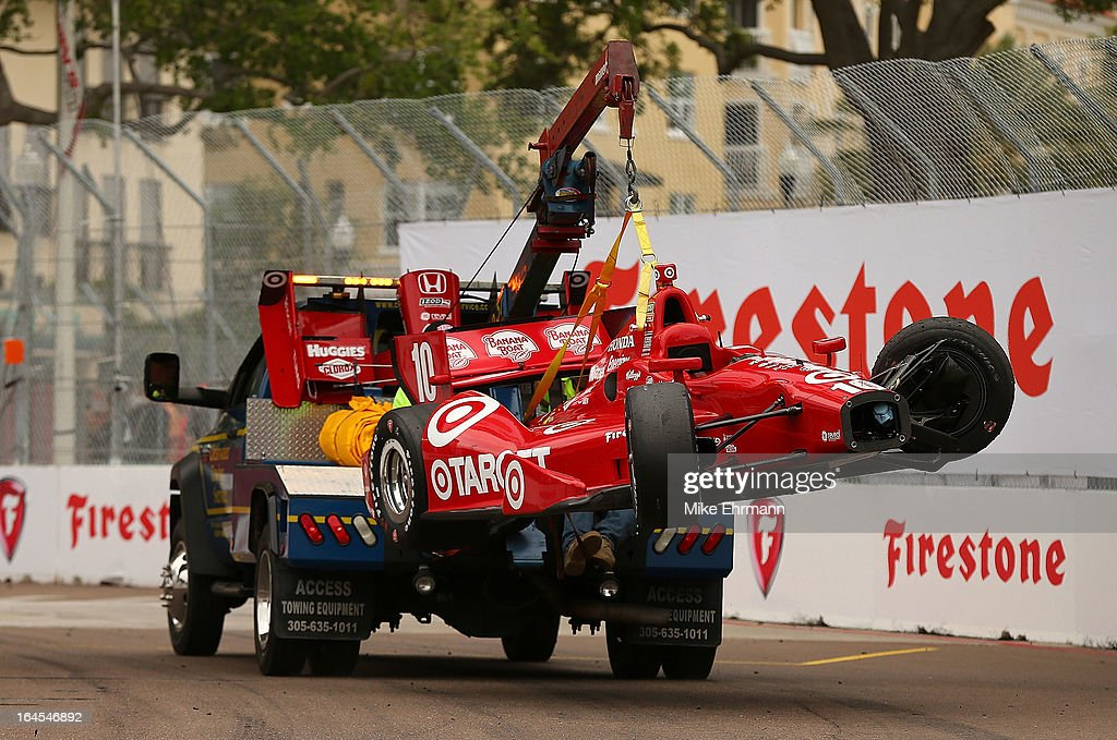Dario Franchitti of Scotland's car, the #10 Target Chip Ganassi Racing Dallara Honda is towed away after a crash during the Honda Grand Prix of St. Petersburg on March 24, 2013 in St Petersburg, Florida.
