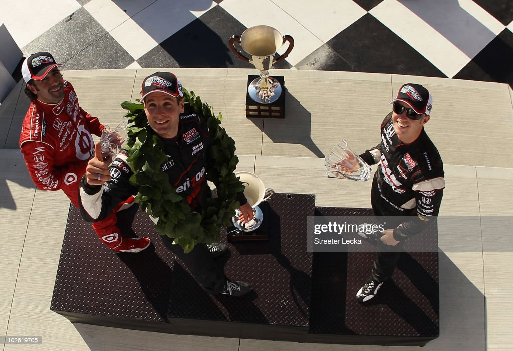 Dario Franchitti, Will Power and Ryan Briscoe celebrate on the podium after the the IZOD IndyCar Series Camping World Grand Prix at the Glen at Watkins Glen International on July 4, 2010 in Watkins Glen, New York.