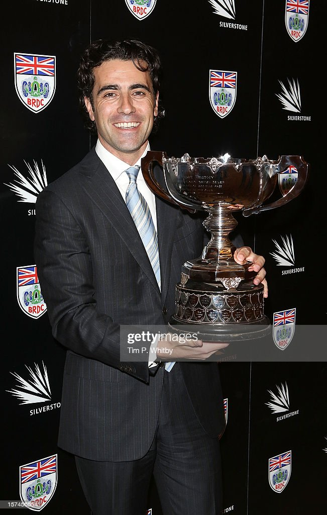 <a gi-track='captionPersonalityLinkClicked' href=/galleries/search?phrase=Dario+Franchitti&family=editorial&specificpeople=171306 ng-click='$event.stopPropagation()'>Dario Franchitti</a> with the Earl Howe Trophy awarded after his victory at the 2012 Indy 500 at the British Racing Drivers Club awards at Grand Connaught Rooms on December 3, 2012 in London, England.
