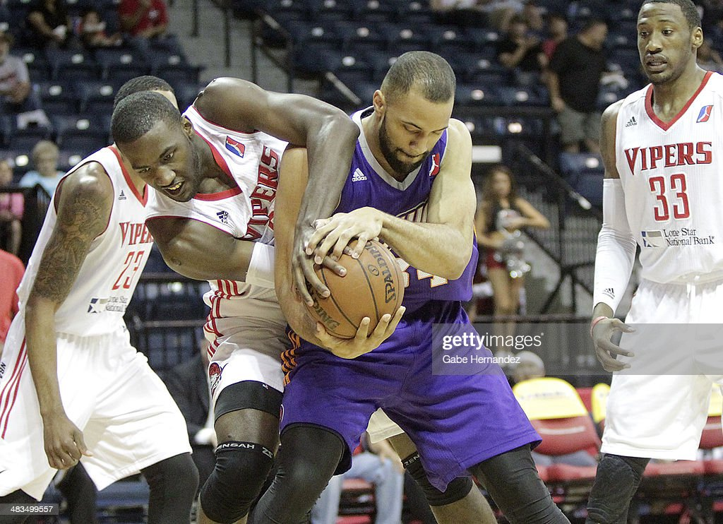 Dario Hunt #22 of the Rio Grande Valley Vipers fights for the ball against Jackie Carmichael #34 of the Iowa Energy on April 8, 2014 during game one first round of the 2014 NBA-Development League playoffs at the State Farm Arena in Hidalgo, Texas.