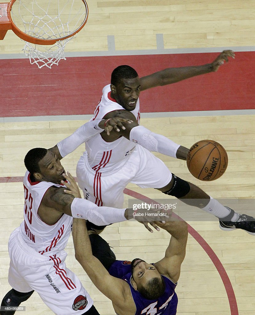 Dario Hunt #22, top, of the Rio Grande Valley Vipers and Robert Covington #33, left, jump for the rebound against Jackie Carmichael #34 of the Iowa Energy on April 8, 2014 during game one first round of the 2014 NBA-Development League playoffs at the State Farm Arena in Hidalgo, Texas.