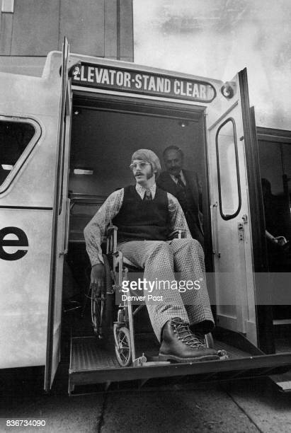Dario Koldenhoven above 6030 E Dartmouth Ave rides the lift that takes him from ground level to bus interior in an innovative bus for the handicapped...