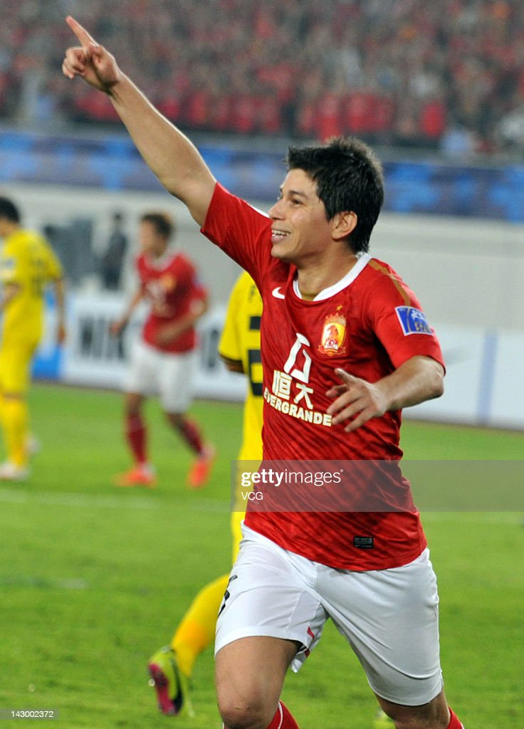 Dario Leonardo Conca of Guangzhou Evergrande celebrates after scoring his team's first goal with a penalty during the AFC Champions League Group H...