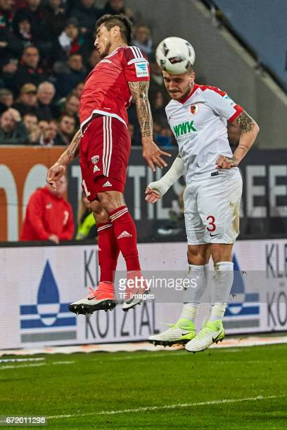 Dario Lezcano and Konstantinos Stafylidis controls the ball during the Bundesliga match between FC Augsburg and FC Ingolstadt 04 at WWK Arena on...