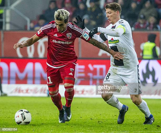 Dario Lezcano Farina of FC Ingolstadt 04 is challenged by Mike Frantz of SC Freiburg during the Bundesliga match between FC Ingolstadt 04 and SC...