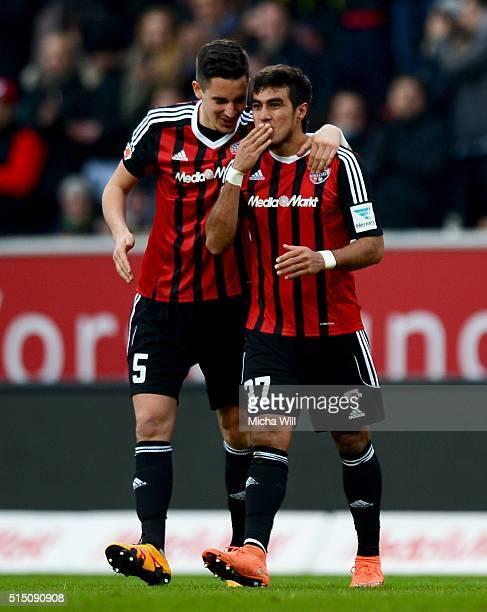Dario Lezcano Farina of Ingolstadt celebrates with Benjamin Huebner of Ingolstadt after scoring his team's third goal during the Bundesliga match...