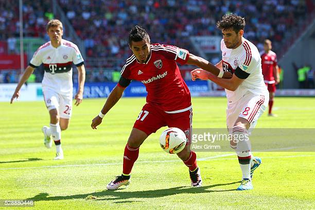 Dario Lezcano of FC Ingolstadt and Javier Martinez of Bayern Muenchen compete for the ball during the Bundesliga match between FC Ingolstadt and FC...