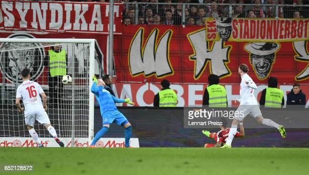 Dario Lezcano of FC Ingolstadt scores his side's first goal during the Bundesliga match between FC Ingolstadt 04 and 1 FC Koeln at Audi Sportpark on...