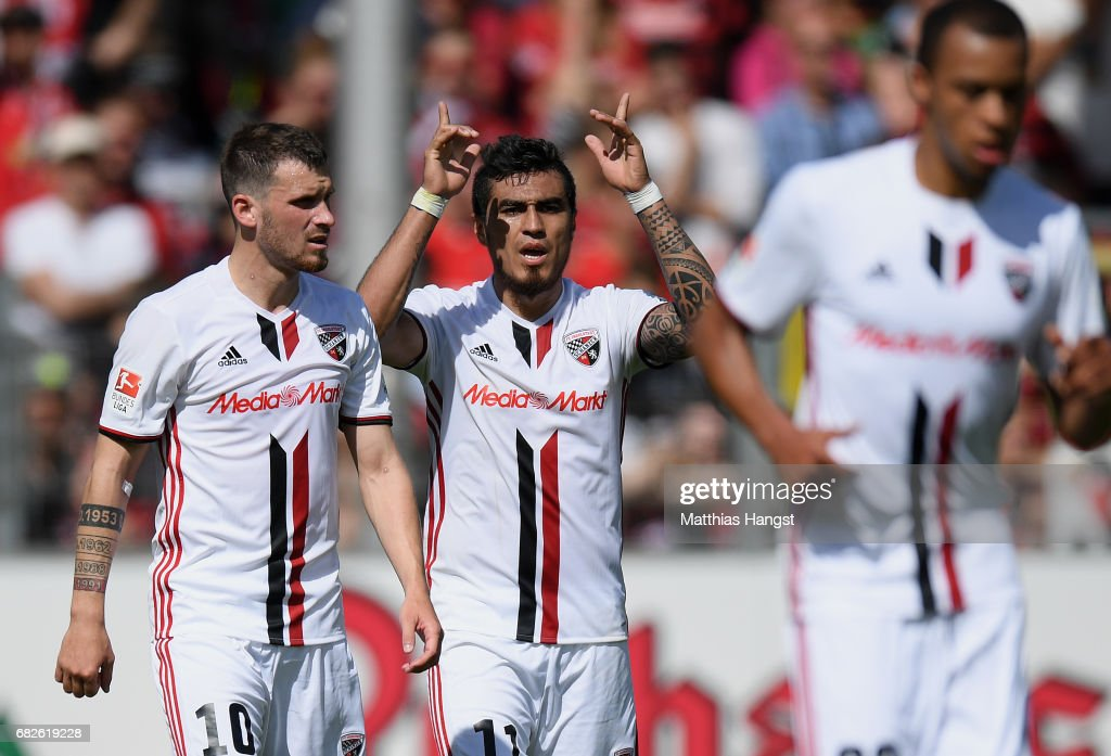 Dario Lezcano (C) of Ingolstadt celebrates with his team-mates after scoring his team's first goal during the Bundesliga match between SC Freiburg and FC Ingolstadt 04 at Schwarzwald-Stadion on May 13, 2017 in Freiburg im Breisgau, Germany.