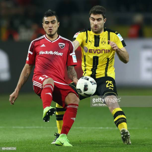 Dario Lezcano of Ingolstadt is challenged by Sokratis Papastathopoulos of Dortmund during the Bundesliga match between Borussia Dortmund and FC...