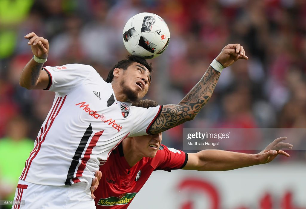 Dario Lezcano of Ingolstadt jumps for a header with Marc-Oliver Kempf of Freiburg during the Bundesliga match between SC Freiburg and FC Ingolstadt 04 at Schwarzwald-Stadion on May 13, 2017 in Freiburg im Breisgau, Germany.