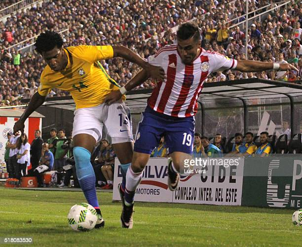 Dario Lezcano of Paraguay and Gil of Brazil fight for the ball during a match between Paraguay and Brazil as part of FIFA 2018 World Cup Qualifiers...
