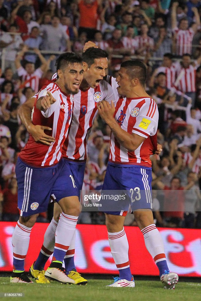 Dario Lezcano of Paraguay (L) celebrates with teammates <a gi-track='captionPersonalityLinkClicked' href=/galleries/search?phrase=Roque+Santa+Cruz&family=editorial&specificpeople=224915 ng-click='$event.stopPropagation()'>Roque Santa Cruz</a> (C) and Richard Ortiz after scoring the first goal of his team during a match between Paraguay and Brazil as part of FIFA 2018 World Cup Qualifiers at Defensores del Chaco Stadium on March 29, 2016 in Asuncion, Paraguay.