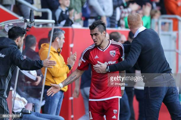 Dario Lezcanoof Ingolstadt shakes hands with Head coach Maik Walpurgisof Ingolstadt during the Bundesliga match between FC Ingolstadt 04 and 1 FSV...