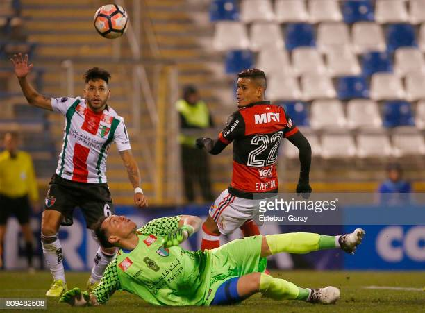Dario Melo of Palestino fights for the ball with Everton Ribeiro of Flamengo during a match between Palestino and Flamengo as part of second round of...