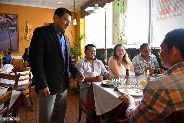 Dario Orellana who owns El Aguila chats with regular customers to let them know the restaurant will have to move out of the way of Purple Line...
