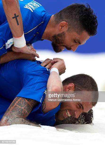 Dario Ramacciotti of Italy celebrates a goal with his teammates Gabriele Gori and Michele di Palma during the FIFA Beach Soccer World Cup Bahamas...