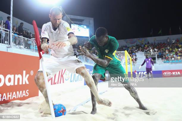 Dario Ramacciotti of Italy is challenged by Mamadou Sylla of Senegal during the FIFA Beach Soccer World Cup Bahamas 2017 quarter final match between...