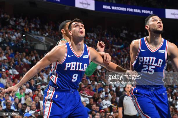Dario Saric and Ben Simmons of the Philadelphia 76ers play defense against the Boston Celtics during the game on October 20 2017 at Wells Fargo...
