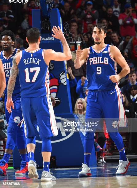 Dario Saric and JJ Redick of the Philadelphia 76ers share a moment after the play against the Utah Jazz at Wells Fargo Center on November 20 2017 in...
