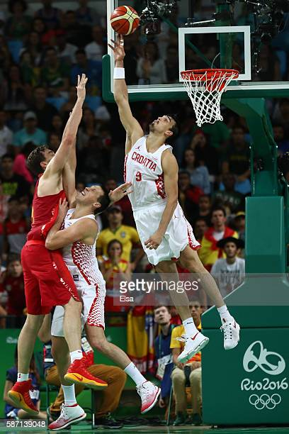 Dario Saric of Croatia blocks Pau Gasol of Spain during a Men's preliminary round basketball game between Croatia and Spain on Day 2 of the Rio 2016...