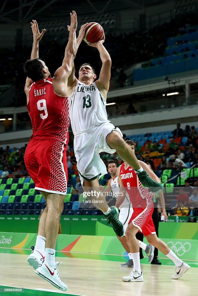 Dario Saric of Croatia challenges Paulius Jankunas of Lithuania during a Men's Basketball Preliminary Round Group B game between Lithuania and Croatia on August 15, 2016 in Rio de Janeiro, Brazil.