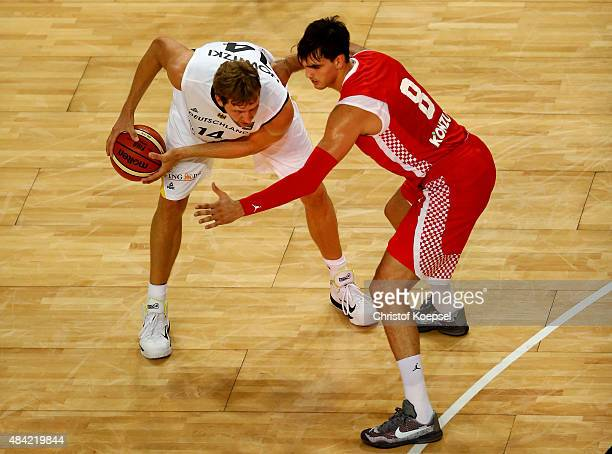 Dario Saric of Croatia defends against Dirk Nowitzki of Germany during the men's Basketball friendly match between Germany and Croatia at OEVBArena...