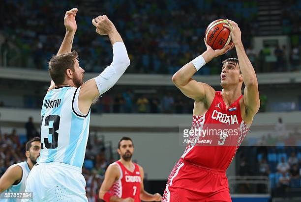 Dario Saric of Croatia shoots the ball against Andres Nocioni of Argentina during a preliminary round basketball game between Croatia and Argentina...