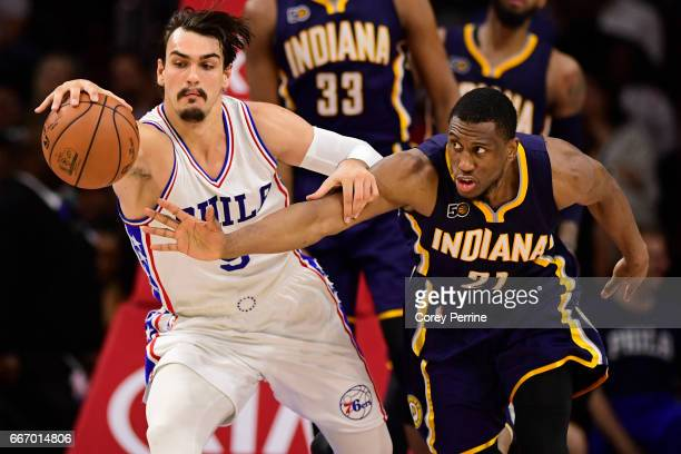 Dario Saric of the Philadelphia 76ers and Thaddeus Young of the Indiana Pacers fight for the ball during the fourth quarter at the Wells Fargo Center...