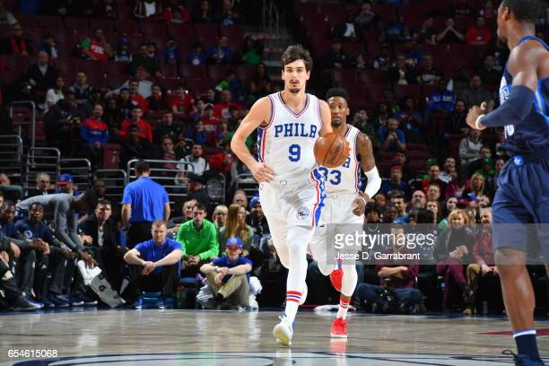 Dario Saric of the Philadelphia 76ers dribbles up court against the Dallas Mavericks at Wells Fargo Center on March 17 2017 in Philadelphia...