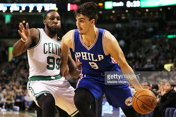 Dario Saric of the Philadelphia 76ers drives against Jae Crowder of the Boston Celtics during the first half at TD Garden on January 6 2017 in Boston...
