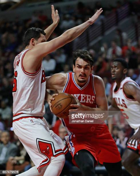 Dario Saric of the Philadelphia 76ers drives against Paul Zipser of the Chicago Bulls at the United Center on March 24 2017 in Chicago Illinois NOTE...