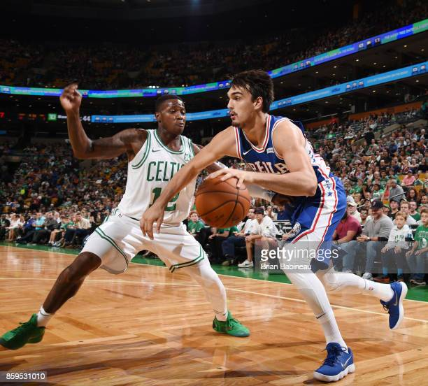 Dario Saric of the Philadelphia 76ers handles the ball against the Boston Celtics during the preseason game on October 9 2017 at the TD Garden in...