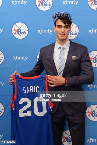 Dario Saric of the Philadelphia 76ers poses for a photo after being drafted by the Philadelphia 76ers at the Wells Fargo Center on June 28 2014 in...
