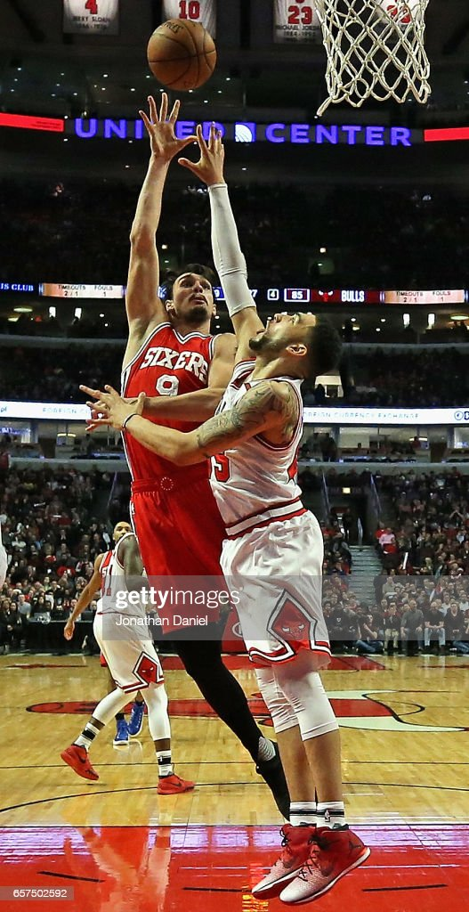 Dario Saric #9 of the Philadelphia 76ers shoots over Denzel Valentine #45 of the Chicago Bulls at the United Center on March 24, 2017 in Chicago, Illinois. The 76ers defeated the Bulls 117-107.