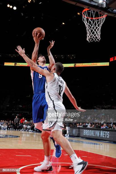 Dario Saric of the Philadelphia 76ers shoots the ball against the Brooklyn Nets on October 11 2017 at Nassau Veterans Memorial Coliseum in Uniondale...