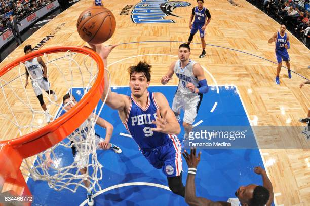 Dario Saric of the Philadelphia 76ers shoots the ball during a game against the Orlando Magic on February 9 2017 at Amway Center in Orlando Florida...