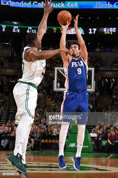 Dario Saric of the Philadelphia 76ers shoots the ball during the preseason game against the Boston Celtics on October 9 2017 at the TD Garden in...