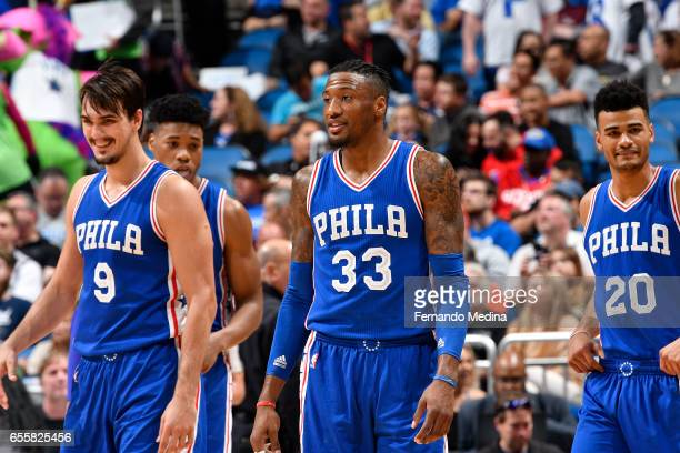 Dario Saric Robert Covington and Timothe LuwawuCabarrot of the Philadelphia 76ers are seen during the game against the Orlando Magic on March 20 2017...