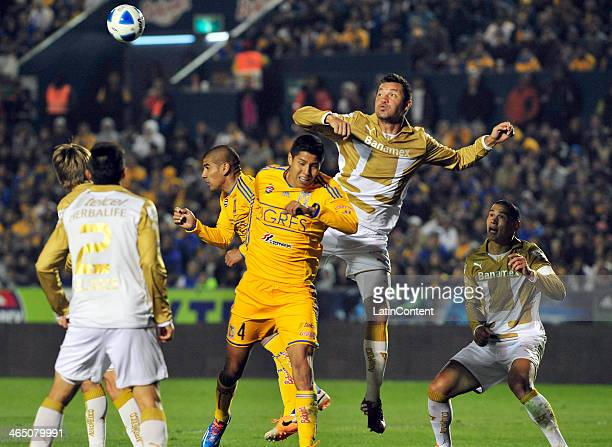 Dario Veron of Pumas competes for the ball with Dante Lopez and Hugo Ayala of Pumas during a match between Tigres UANL and Pumas UNAM as part of the...