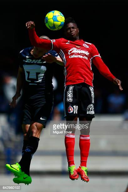 Dario Veron of Pumas fights for the ball with Aviles Hurtado of Xolos during the 7th round match between Pumas UNAM and Tijuana as part of the Torneo...