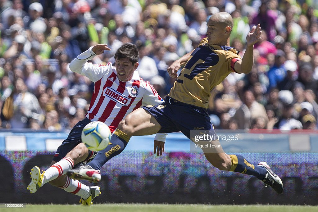 Dario Veron of Pumas fights for the ball with Luis Morales of Chivas during a match between Pumas and Chivas as part of the Clausura 2013 at Olympic stadium on March 03, 2013 in Mexico City, Mexico.