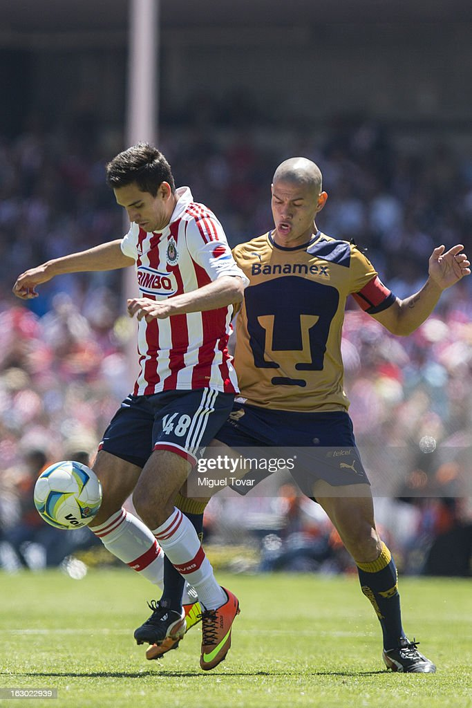 Dario Veron (R) of Pumas struggles for the ball with Raul Lopez (L) of Chivas during a match between Pumas and Chivas as part of Clausura 2013 Liga MX at Olympic Stadium on March 03, 2013 in Mexico City, Mexico.