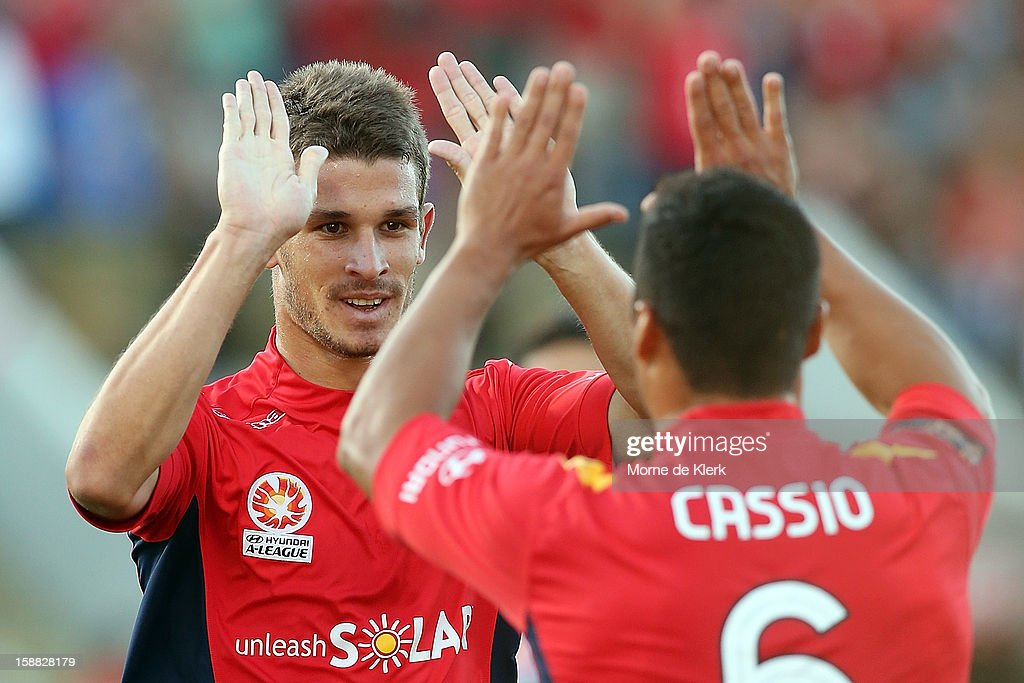 Dario Vidosic and Cassio of Adelaide celebrate after Vidosic scored a goal during the round 14 A-League match between Adelaide United and Sydney FC at Hindmarsh Stadium on December 31, 2012 in Adelaide, Australia.