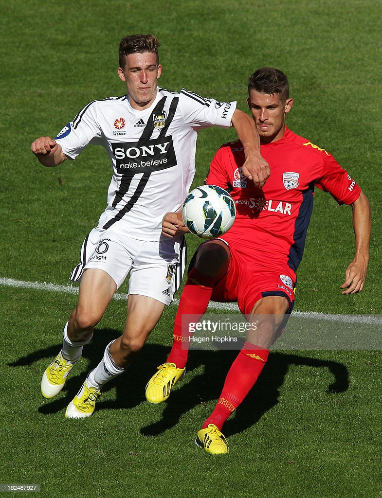 Dario Vidosic of Adelaide and Louis Fenton of the Phoenix compete for the ball during the round 22 A-League match between the Wellington Phoenix and Adelaide United at Westpac Stadium on February 24, 2013 in Wellington, New Zealand.